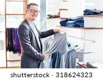 handsome young man choosing... | Shutterstock . vector #318624323