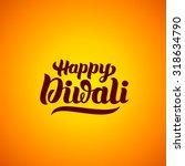 happy diwali hand lettering.... | Shutterstock .eps vector #318634790