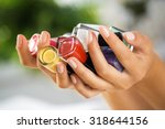 close up of woman hands with... | Shutterstock . vector #318644156