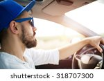 close up of young man driving... | Shutterstock . vector #318707300