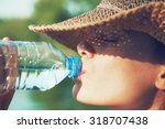 Woman Drinking Water In Summer...