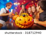 carved pumpkin and spider on... | Shutterstock . vector #318712940