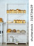 bread on shelves in store | Shutterstock . vector #318734639