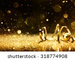 golden streamers with sparkling ... | Shutterstock . vector #318774908