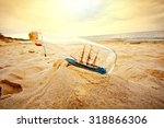Ship In The Bottle Lying On Th...