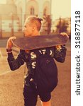 Small photo of Vintage image of a man with longboard going on road,hipster young teen boy,b-boy,hiker man,skater bag,sunset lights,mans hairstyle,mans fashion,urban street style,swagger bag