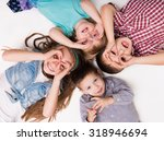 children lying on the floor... | Shutterstock . vector #318946694