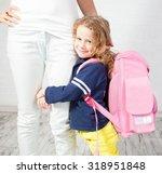 mother helps her daughter get... | Shutterstock . vector #318951848