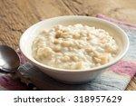 oatmeal porridge in bowl for... | Shutterstock . vector #318957629