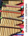 Small photo of close-up Pan flute made of natural materials handmade in sunlight