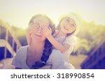 daughter hugging mother on... | Shutterstock . vector #318990854