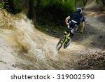 mountainbiker rides on forest... | Shutterstock . vector #319002590