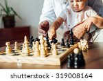 little girl in chess move