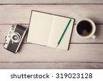 vintage camera  open notebook... | Shutterstock . vector #319023128