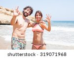 happy couple in a beach | Shutterstock . vector #319071968