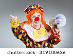 clown with loudspeaker isolated ... | Shutterstock . vector #319100636