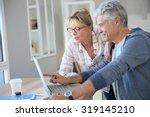 senior couple at home checking... | Shutterstock . vector #319145210