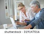 senior couple at home checking... | Shutterstock . vector #319147016
