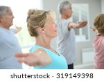 senior people stretching out in ... | Shutterstock . vector #319149398