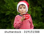sweet boy in striped shirt with ... | Shutterstock . vector #319151588