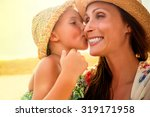 Mothers Love Daughter Kissing...