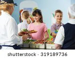 Stock photo pupils being served with healthy lunch in school canteen 319189736