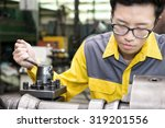 Mechanical Engineering control lathe machine in factory  - stock photo