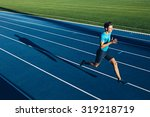 shot of a young male athlete... | Shutterstock . vector #319218719