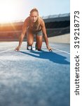young woman sprinter in the... | Shutterstock . vector #319218773