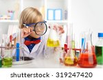 little scientist looking at... | Shutterstock . vector #319247420