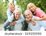 senior men giving piggyback... | Shutterstock . vector #319255550