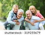 senior men giving piggyback... | Shutterstock . vector #319255679