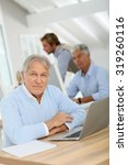 portrait of senior man working... | Shutterstock . vector #319260116