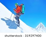 hiker on the trek in himalayas | Shutterstock . vector #319297400