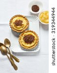 Small photo of mini tart. with lemon Kurd and chocolate. preparing breakfast. space for writing text. copy space.