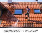 roof cleaning with high pressure | Shutterstock . vector #319361939