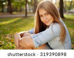young pretty girl in autumn park | Shutterstock . vector #319390898