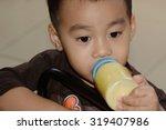 cute little boy with bottle of ... | Shutterstock . vector #319407986