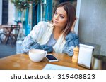 young woman in a cafe | Shutterstock . vector #319408823