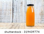 Juice Bottle On Wood Backgroun...