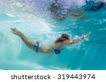 Lady Swimming Underwater In Th...