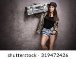 teenage girl carrying a ghetto... | Shutterstock . vector #319472426