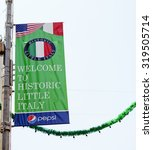 Small photo of New York, New York, USA - June 20, 2011: A Little Italy banner affixed to a lamppost in the Little Italy section of Lower Manhattan.