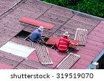 Man Workers Replacing Damaged...