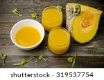 pumpkin and soup on wooden... | Shutterstock . vector #319537754