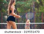 beautiful female tennis players ... | Shutterstock . vector #319551470