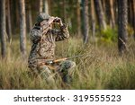 man hunter with shotgun looking ... | Shutterstock . vector #319555523