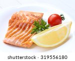 grilled salmon with lemon | Shutterstock . vector #319556180