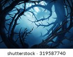 dark forest with thorny bushes... | Shutterstock . vector #319587740