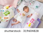 newborn baby taking a nap   Shutterstock . vector #319604828